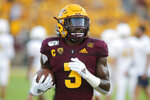 Arizona State running back Eno Benjamin warms up prior to an NCAA college football game against Kent State, Thursday, Aug. 29, 2019, in Tempe, Ariz. (AP Photo/Ralph Freso)