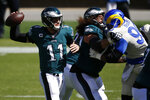 Philadelphia Eagles' Carson Wentz passes during the first half of an NFL football game against the Los Angeles Rams, Sunday, Sept. 20, 2020, in Philadelphia. (AP Photo/Laurence Kesterson)