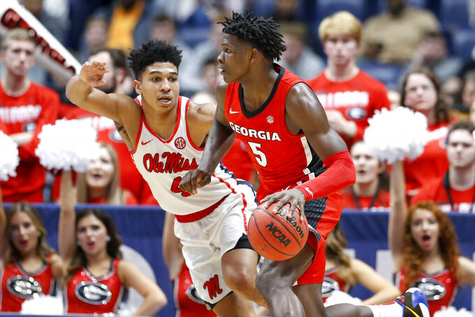 Georgia guard Anthony Edwards (5) drives against Mississippi's Breein Tyree (4) in the second half of an NCAA college basketball game in the Southeastern Conference Tournament Wednesday, March 11, 2020, in Nashville, Tenn. Georgia won 81-63. (AP Photo/Mark Humphrey)
