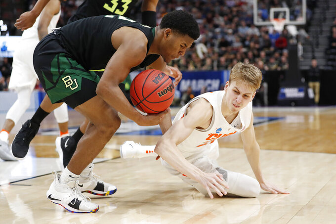 Baylor guard Jared Butler, left, and Syracuse forward Marek Dolezaj (21) scramble for the ball during the second half of a first-round game in the NCAA men's college basketball tournament Thursday, March 21, 2019, in Salt Lake City. (AP Photo/Jeff Swinger)
