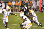 South Carolina wide receiver Shi Smith (13) scores a touchdown against Tennessee's Doneiko Slaughter (18), Trevon Flowers (1) and Bryce Thompson (0) during the second half of an NCAA college football game Saturday, Sept. 26, 2020, in Columbia, S.C. (AP Photo/Sean Rayford)