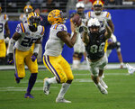LSU safety JaCoby Stevens (3) intercepts the football intended for UCF tight end Michael Colubiale (86) in the second half during the Fiesta Bowl NCAA college football game, Tuesday, Jan. 1, 2019, in Glendale, Ariz. LSU defeated UCF 40-32. (AP Photo/Rick Scuteri)