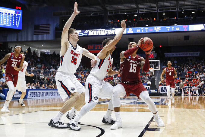 Temple's Nate Pierre-Louis (15) eyes the basket against Belmont's Kevin McClain, center, and Seth Adelsperger (50) during the second half of a First Four game of the NCAA college basketball tournament, Tuesday, March 19, 2019, in Dayton, Ohio. (AP Photo/John Minchillo)
