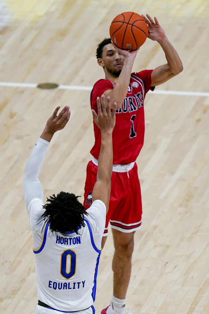 Northern Illinois' Trendon Hankerson (1) shoots over Pittsburgh's Ithiel Horton (0) during the second half of an NCAA college basketball game, Saturday, Dec. 5, 2020, in Pittsburgh. (AP Photo/Keith Srakocic)