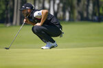 Dustin Johnson, of the United States, lines up a putt on the fifth green during the third round of the US Open Golf Championship, Saturday, Sept. 19, 2020, in Mamaroneck, N.Y. (AP Photo/John Minchillo)