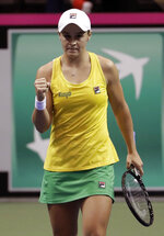 Australia's Ashleigh Barty reacts after defeating United States' Madison Keys during their first-round Fed Cup tennis match in Asheville, N.C., Sunday, Feb. 10, 2019. (AP Photo/Chuck Burton)