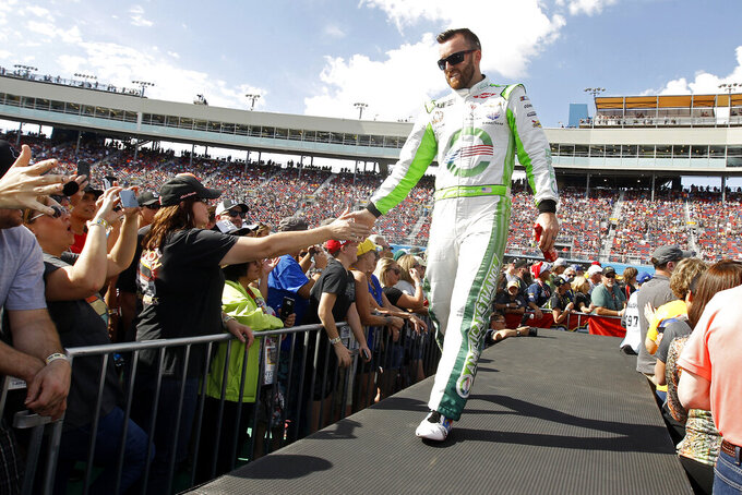 Austin Dillon greets fans during driver introductions prior to the NASCAR Cup Series auto race at ISM Raceway, Sunday, Nov. 10, 2019, in Avondale, Ariz. (AP Photo/Ralph Freso)