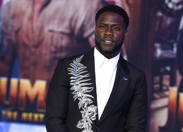 FILE - In this Dec. 9, 2019, file photo, Kevin Hart poses for photographers at the premiere of