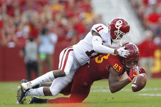 Oklahoma cornerback Parnell Motley, top, breaks up a pass intended for Iowa State wide receiver Jalen Martin, right, during the first half of an NCAA college football game, Saturday, Sept. 15, 2018, in Ames, Iowa. (AP Photo/Matthew Putney)