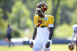 Washington quarterback Dwayne Haskins Jr. (7) walks on the field during practice at the team's NFL football training facility, Monday, Aug. 24, 2020, in Ashburn, Va. (AP Photo/Nick Wass)