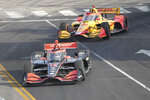 Will Power (12) leads Ryan Hunter-Reay (28) through turn one during the IndyCar Music City Grand Prix auto race Sunday, Aug. 8, 2021, in Nashville, Tenn. (AP Photo/Harrison McClary)