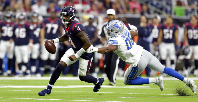 Houston Texans quarterback Deshaun Watson (4) breaks away from Detroit Lions defensive end Romeo Okwara (95) during the first half of an NFL preseason football game Saturday, Aug. 17, 2019, in Houston. (AP Photo/Michael Wyke)