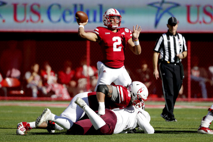 Nebraska quarterback Adrian Martinez (2) throws behind a block by offensive lineman Boe Wilson (56) during the first half of an NCAA college football game against Bethune-Cookman in Lincoln, Neb., Saturday, Oct. 27, 2018. (AP Photo/Nati Harnik)