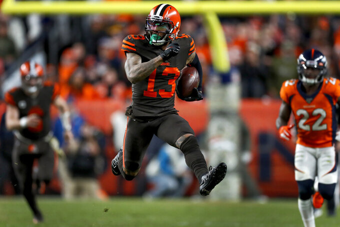 Cleveland Browns wide receiver Odell Beckham (13) runs after the catch against the Denver Broncos during the second half of NFL football game, Sunday, Nov. 3, 2019, in Denver. (AP Photo/David Zalubowski)