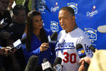 Los Angeles Dodgers manager Dave Roberts is interviewed by reporters during Dodger Stadium FanFest Saturday, Jan. 25, 2020, in Los Angeles. (AP Photo/Mark J. Terrill)