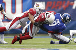 New York Giants quarterback Daniel Jones, right, is sacked by Arizona Cardinals' Jordan Hicks, left, and Chandler Jones (55) during the first half of an NFL football game, Sunday, Oct. 20, 2019, in East Rutherford, N.J. (AP Photo/Adam Hunger)