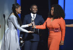 FILE - In this Feb. 6, 2015 file photo, Ava DuVernay, from left, David Oyelowo, and Oprah Winfrey accept the award for outstanding motion picture for