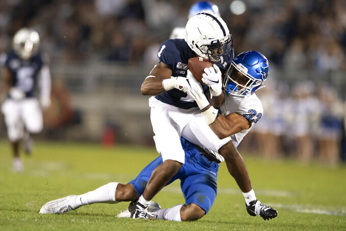 Penn State wide receiver K.J. Hamler (1) catches a pass in front of Buffalo safety Tyrone Hill (33) during the third quarter of an NCAA college football game in State College, Pa., Saturday, Sept. 7, 2019. (AP Photo/Barry Reeger)