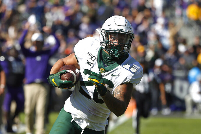 FILE - In this Saturday, Nov. 9, 2019 file photo, Baylor linebacker Terrel Bernard (26) returns an interception against TCU during the second half of an NCAA college football game in Fort Worth, Texas. Major improvements on defense have pushed Oklahoma and Baylor into the Big 12 championship game. Oklahoma led the Big 12 in total defense during conference play after finishing last a season ago. Baylor led the Big 12 in scoring defense and ranked third in total defense in league play a year after finishing seventh in total defense and eighth in scoring defense. (AP Photo/Ron Jenkins, File)