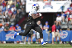Buffalo Bills running back LeSean McCoy runs with the ball during practice at the NFL football team's training camp in Pittsford, N.Y., Thursday, July 25, 2019. (AP Photo/Adrian Kraus)