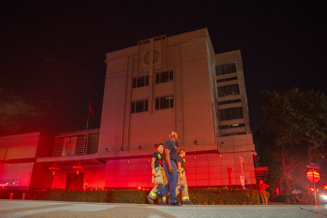 FILE - In this July 21, 2020, file photo the Houston Fire Department responds to reports of a fire inside the Chinese Consulate in Houston. In shutting each other's consulates, the United States and China have done more than strike symbolic blows in their escalating feud. For China, the loss of its mission in Houston dims its view of America's South and, according to U.S. officials, removes the nerve center of a Chinese spying network that spanned more than two dozen cities, collecting intelligence, trying to steal trade secrets and proprietary technology and research. (Mark Mulligan/Houston Chronicle via AP, File)