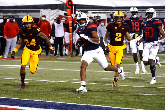Arizona running back Michael Wiley (6) scores a touchdown against Arizona State during the first half during an NCAA college football game Friday, Dec. 11, 2020, in Tucson, Ariz. (AP Photo/Rick Scuteri)