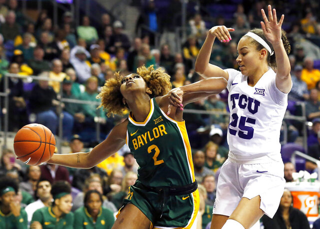 Baylor guard DiDi Richards (2) drives to the basket against Texas Christian guard Kianna Ray (25) during the second half of an NCAA college basketball game in Fort Worth, Texas, Wednesday, Jan. 22, 2020. Baylor won 66-57. (AP Photo/Ray Carlin)