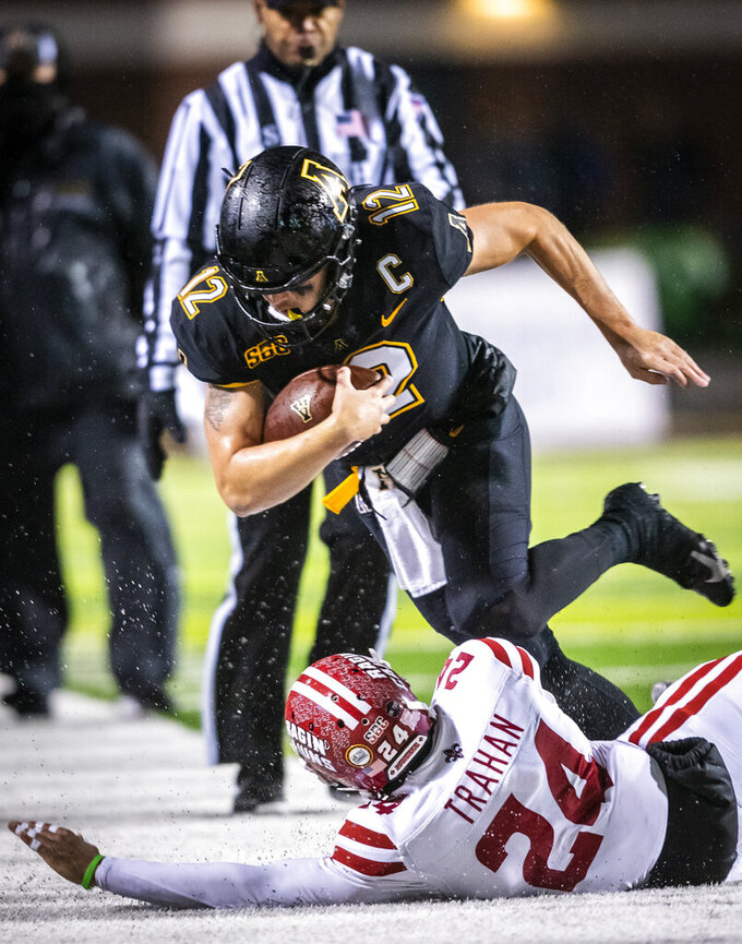 Appalachian State quarterback Zac Thomas (12) is knocked out of bounds, after making a first down, by Louisiana-Lafayette safety Bralen Trahan (24) during an NCAA college football game Friday, Dec. 4, 2020, in Boone, N.C. (Andrew Dye/The Winston-Salem Journal via AP, Pool)