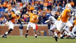 Tennessee quarterback Jarrett Guarantano (2) throws to Tim Jordan, foreground right, in the first half of an NCAA college football game against Kentucky Saturday, Nov. 10, 2018, in Knoxville, Tenn. (AP Photo/Wade Payne)