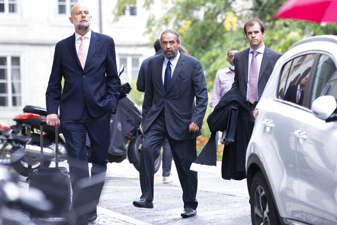 Sheikh Ahmad al-Fahad al-Sabah, center, arrives at a Geneva's courthouse ahead of the verdict for a trial for forgery in connection with arbitration, in Geneva, Switzerland, Friday, Sept. 10, 2021. (Salvatore Di Nolfi/Keystone via AP)