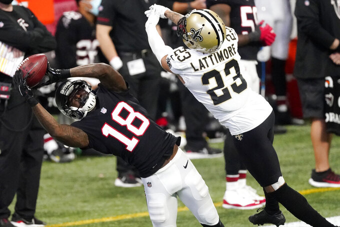 Atlanta Falcons wide receiver Calvin Ridley (18) makes a catch against New Orleans Saints cornerback Marshon Lattimore (23) during the first half of an NFL football game, Sunday, Dec. 6, 2020, in Atlanta. (AP Photo/John Bazemore)