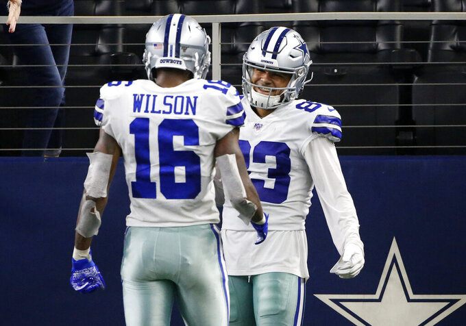 Dallas Cowboys wide receiver Ced Wilson (16) and wide receiver Jalen Guyton (83) celebrate after Guyton caught a touchdown pass in the second half of a preseason NFL football game against the Tampa Bay Buccaneers in Arlington, Texas, Thursday, Aug. 29, 2019. (AP Photo/Ron Jenkins)