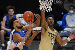 Kentucky forward Olivier Sarr, left, battles Georgia Tech guard Kyle Sturdivant, right, during the second half of an NCAA college basketball game Sunday, Dec. 6, 2020, in Atlanta. (AP Photo/John Bazemore)