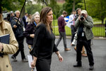 White House press secretary Sarah Huckabee Sanders walks into the West Wing of the White House after speaking members of the media, Thursday, May 16, 2019, in Washington. (AP Photo/Andrew Harnik)