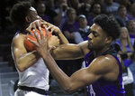 Kansas State guard Kamau Stokes, left, rebounds against TCU center Russell Barlow, right, during the first half of an NCAA college basketball game in Manhattan, Kan., Saturday, Jan. 19, 2019. (AP Photo/Orlin Wagner)
