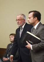 William Strampel, left, former dean at the College of Osteopathic Medicine at Michigan State University in East Lansing, Michigan, enters Ingham County Circuit Court Wednesday, June 12, 2019, with his attorney John Dakmak. Strample was found guilty Wednesday of neglect of duty and misconduct in office but acquitted on a more serious criminal sexual conduct charge.   (Matthew Dae Smith/Lansing State Journal via AP)