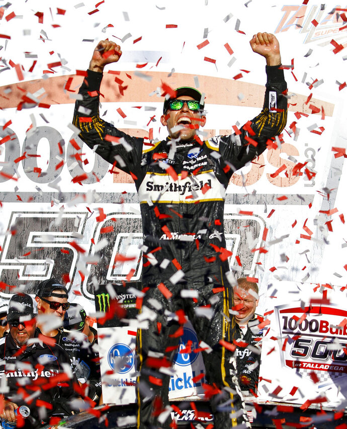Aric Almirola celebrates in Victory Lane after winning the 1000Bulbs.com 500 NASCAR Cup Series auto race at Talladega Superspeedway, Sunday, Oct. 14, 2018, in Talladega, Ala. (AP Photo/Butch Dill)