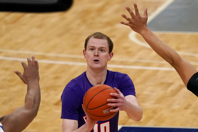 Evansville's Evan Kuhlman (10) shoots during the first half of an NCAA college basketball game against Indiana State in the quarterfinal round of the Missouri Valley Conference men's tournament Friday, March 5, 2021, in St. Louis. (AP Photo/Jeff Roberson)