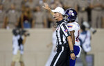 Official Ken Williamson waves a touchback signal after Northwestern State wide receiver Myles Ward (10) called for a fair catch on a kickoff from Texas A&M during an NCAA college football game Thursday, Aug. 30, 2018, in College Station, Texas. Under a new rule, if a fair catch is made on a kick inside the 25, it's a touchback. A fair catch beyond the 25 is marked at that spot, like on a punt. A muffed fair catch also is marked at the spot regardless of which team recovers. The purpose is to increase the number of touchbacks on kickoffs as a way to enhance player safety. Research has shown kick returns are among the most dangerous plays. (AP Photo/Sam Craft)