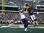 FILE - Minnesota Vikings' Adam Thielen (19) catches a touchdown against Philadelphia Eagles' Ronald Darby (21) during the first half of an NFL football game, Sunday, Oct. 7, 2018, in Philadelphia. The coronavirus pandemic scuttled most college pro days, wiped out all rookie minicamps and obliterated the NFL's traditional offseason. Thielen went undrafted in 2013 out of Minnesota State but parlayed an impressive weekend at a rookie minicamp into a practice squad job and eventually a roster spot. (AP Photo/Matt Rourke, File)