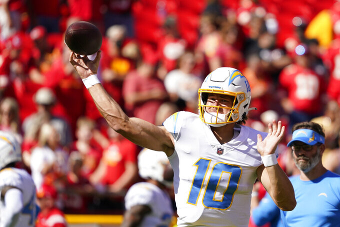Los Angeles Chargers quarterback Justin Herbert (10) throws before an NFL football game between the Kansas City Chiefs and the Los Angeles Chargers, Sunday, Sept. 26, 2021, in Kansas City, Mo. (AP Photo/Ed Zurga)