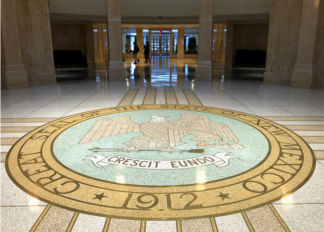 Visitors trickle into the New Mexico state Capitol building in Santa Fe, N.M., on Thursday, Jan. 16, 2020, as lawmakers prepare for a 30 legislative session. Gov. Michelle Lujan Grisham says she'll consider red-flag gun legislation, proposals to legalize recreational marijuana and new incentives for localized renewable energy installations electric car purchases. Spending increases are proposed for K-12 education, early childhood programs, tuition-free college and more amid a budget surplus. (AP Photo/Morgan Lee)