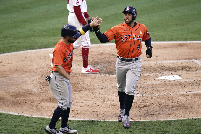 Houston Astros' George Springer, right, and Jack Mayfield high-five after they scored on a single hit by Yuli Gurriel during the third inning of the first baseball game of a doubleheader against the Los Angeles Angels, Saturday, Sept. 5, 2020, in Anaheim, Calif. (AP Photo/Jae C. Hong)