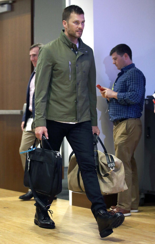 FILE - In this Oct. 4, 2018, file photo, New England Patriots quarterback Tom Brady arrives to speak to the media following an NFL football game against the Indianapolis Colts in Foxborough, Mass. Tom Brady is an NFL free agent for the first time in his career.  The 42-year-old quarterback with six Super Bowl rings  said Tuesday morning, March 17, 2020, that he is leaving the New England Patriots. (AP Photo/Charles Krupa, File)
