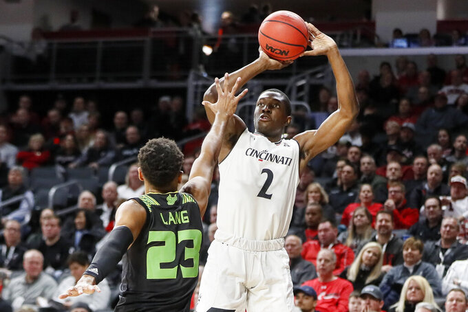 Cincinnati's Keith Williams (2) shoots over South Florida's T.J. Lang (23) in the first half of an NCAA college basketball game, Tuesday, Jan. 15, 2019, in Cincinnati. (AP Photo/John Minchillo)