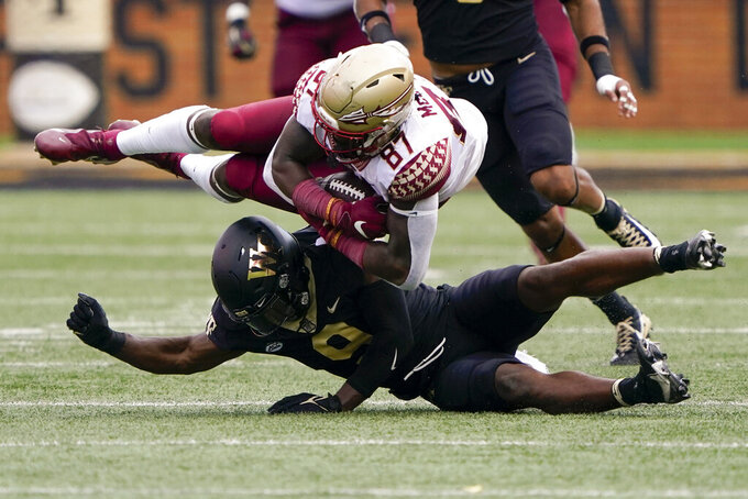 Florida State tight end Camren McDonald (87) is tackled by Wake Forest defensive back Chelen Garnes, bottom, during the first half of an NCAA college football game Saturday, Sept. 18, 2021, in Winston-Salem, N.C. (AP Photo/Chris Carlson)