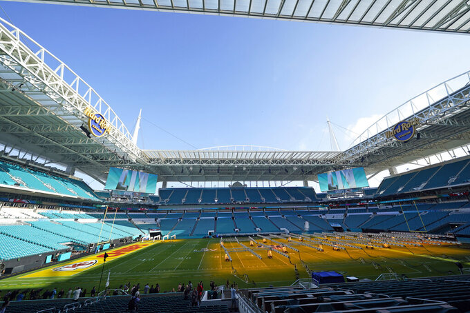 Grow lights cover a portion of the grass field inside Hard Rock Stadium Tuesday, Jan. 28, 2020, in Miami Gardens, Fla., in preparation for the NFL Super Bowl 54 football game. (AP Photo/David J. Phillip)