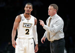FILE - In this Monday, Nov. 19, 2018, file photo, Virginia Commonwealth head coach Mike Rhoades, right, talks to Marcus Evans (2) during the second half of an NCAA college basketball game in the Legends Classic tournament in New York. The Rams have 25 wins and are the top seed in the Atlantic 10 men's basketball tournament. (AP Photo/Frank Franklin II, File)