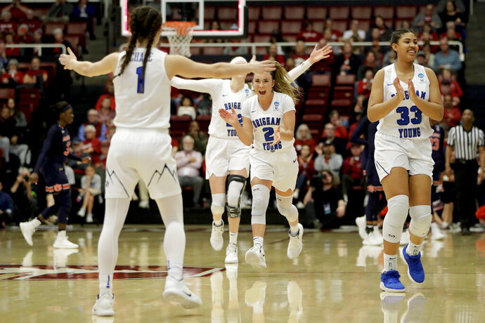 BYU celebrates after their win against Auburn during a first-round game in the NCAA women's college basketball tournament in Stanford, Calif. Saturday, March 23, 2019. (AP Photo/Chris Carlson)