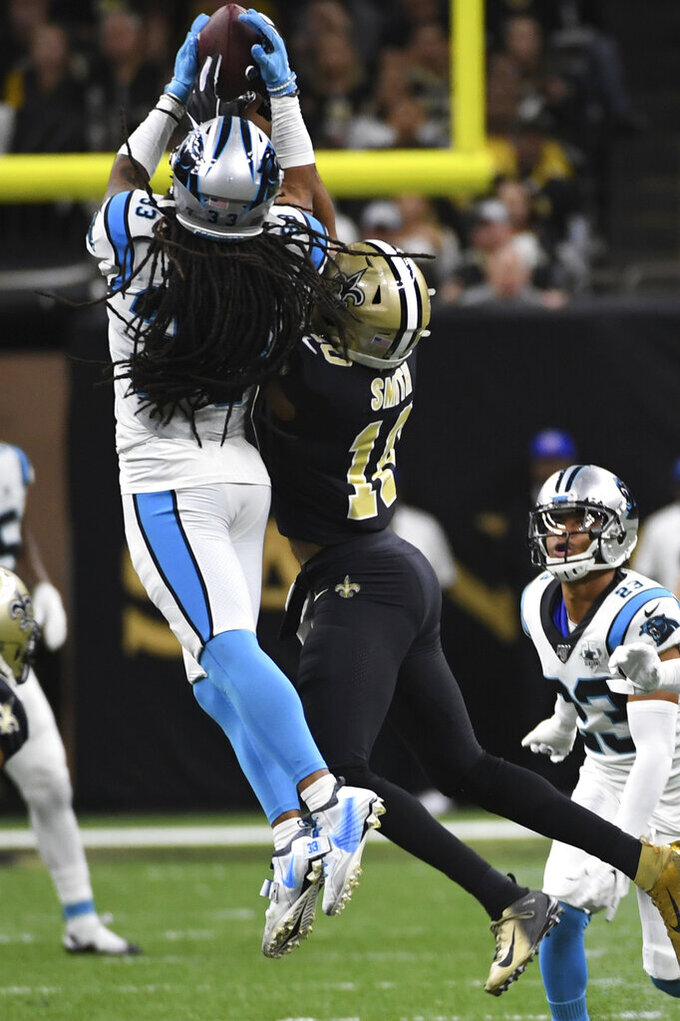 Carolina Panthers free safety Tre Boston (33) intercepts a pass intended for New Orleans Saints wide receiver Tre'Quan Smith (10), during the second half at an NFL football game, Sunday, Nov. 24, 2019, in New Orleans. (AP Photo/Bill Feig)